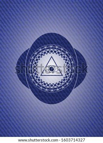 illuminati pyramid icon inside emblem with jean texture