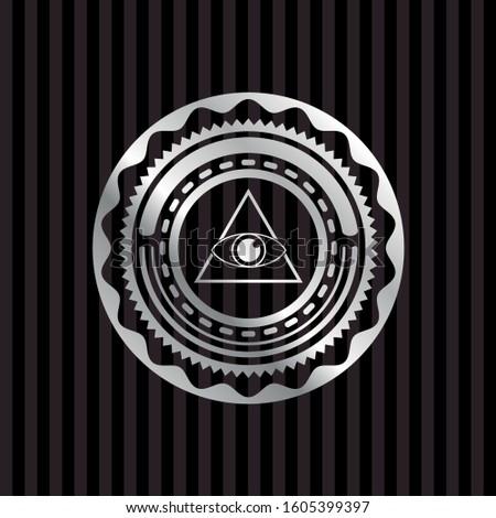 illuminati pyramid icon inside silvery badge or emblem