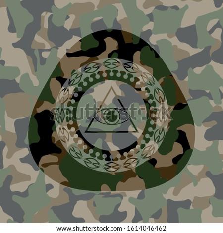 illuminati pyramid icon on camo texture