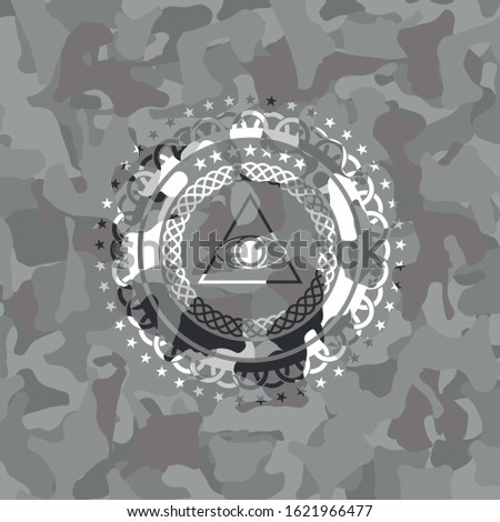 illuminati pyramid icon on grey camo pattern