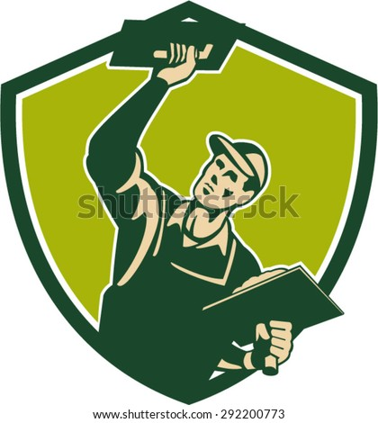 Illustration of a plasterer masonry tradesman construction worker with trowel plastering viewed from front set inside shield crest done in retro style on isolated background
