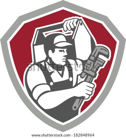 Illustration of a plumber carrying toolbox on shoulder and holding monkey wrench set inside shield facing side done in retro style on isolated background