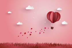 illustration of love and valentine day,Origami made hot air balloon flying over grass with heart float on the sky.paper art and  digital craft style.