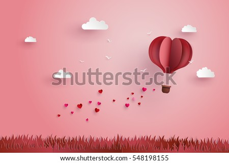 illustration of love and valentine day,Origami made hot air balloon flying over grass with heart float on the sky.paper art and  digital craft style. stock photo
