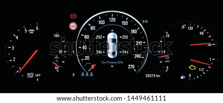 Illustration of TPMS (Tyre Pressure Monitoring System) monitoring display on car dashboard panel. The pressure measurement given in kPa. Malfunction check engine warning light control on car dashboard