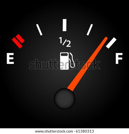 Image of a gas gage on a dark background.