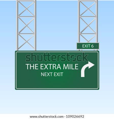 "Image of a highway sign with an exit to ""The Extra Mile"" against a blue sky background."