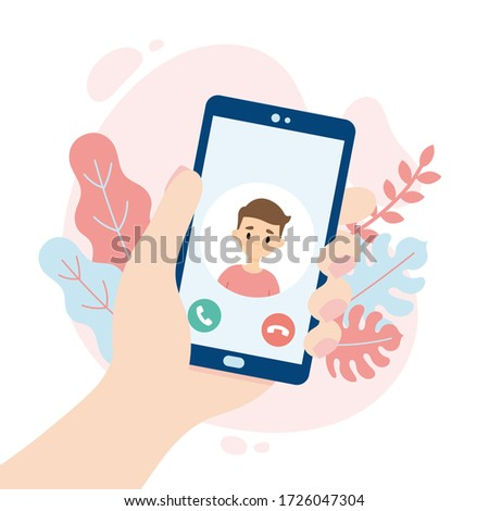 Incoming video call. Hand holding a smartphone. Cute boy making a video call. People using a video call app while social distancing.