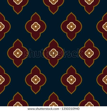 Indian paisley pattern folk floral motif. Arrangement of tiny flowers in simple geometric shapes. Oriental ornament navy blue background. Elegant print block for apparel textile, silk fabric, garment.
