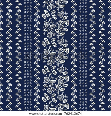 Indigo block printed seamless ornament. Vector ethnic floral pattern, Russian folk motif with leaves, vines and stripes of blocks, ecru on navy blue background. Textile print.