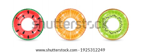 Inflatable rings looking like kiwi, orange and watermelon isolated on white background. Realistic colorful rubber swimming buoy. Vector illustration of top view at pool floater in fruit shape Сток-фото ©