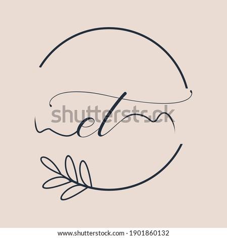 Initial ET logo Handwriting floral and botanical vector Stok fotoğraf ©