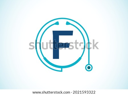 Initial F monogram alphabet with doctor stethoscope. Vector stethoscope logo or icon. Logo for medical and pharmaceutical business and company identity Foto stock ©