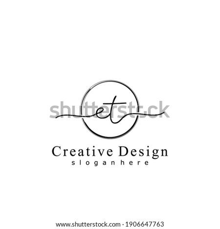 Initial letter ET calligraphy handwritten logo. Handwritten alphabet in the logo template. Letters and Alphabet for your logo design. Stok fotoğraf ©