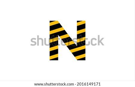 Initial letter N black and  yellow warning tape flat minimalist icon logo design symbol Stock fotó ©