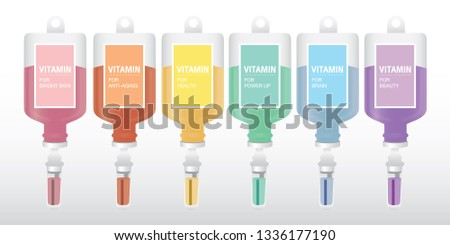 Injection Bottles of Vitamin Drip Therapy for Health and Skin, on White Background.