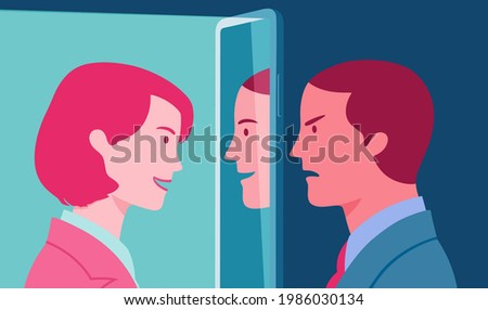 Insincere young businessman who pretends to be friendly with a female colleague using fake personality online. Liar man who hides from a young woman his hostility.  Foto stock ©