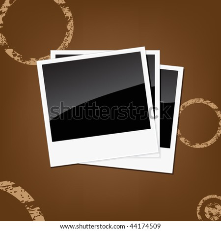 Instant photos isolated on a brown background