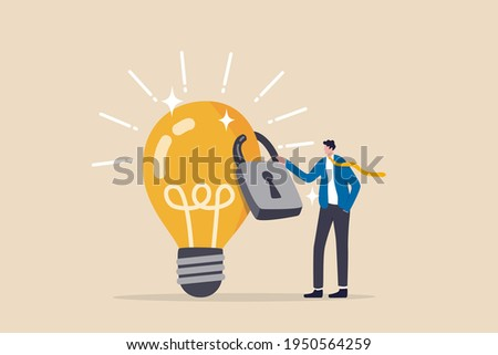 Intellectual property, patented protection, copyright reserved or product trademark that cannot copy concept, businessman owner standing with light bulb idea locked with padlock for patents. Сток-фото ©