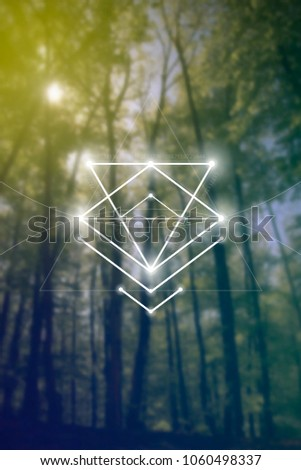 Interlocking circles and triangles sacred geometry illustration with golden ratio digits in front of photographic background.