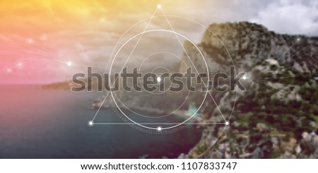 Interlocking circles, triangles and spirals hipster sacred geometry illustration with golden ratio digits and light dots in front of photographic background.