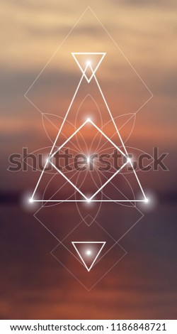 Interlocking circles, triangles and squares hipster sacred geometry illustration with flower ornament and  light dots in front of photographic background.