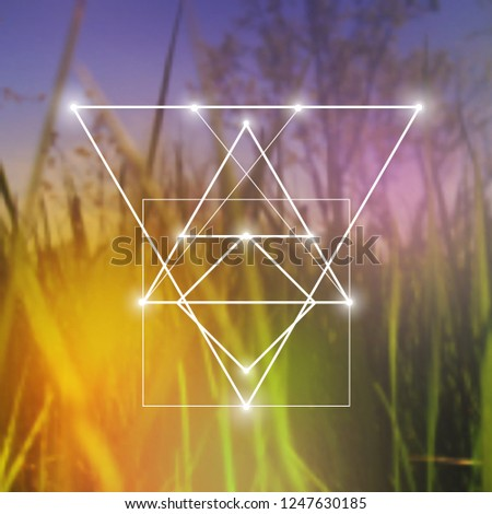 Interlocking circles, triangles and squares hipster sacred geometry illustration with light dots in front of photographic background.