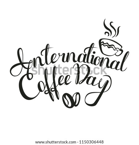 International Coffee Day. 1 October. Food event concept. Lettering handmade with the name of the event inscribed in the cup.