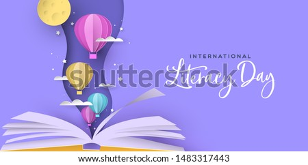 International Literacy Day greeting card illustration of open book with cute paper hot air balloons in modern papercut style. Children education or reading imagination concept for learning event.