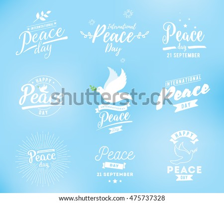 International peace day typography. Greeting card for 21 september. Peace day vector logo design. Dove with branch in the sky.