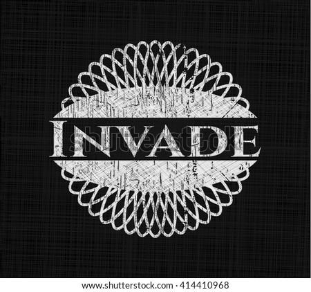 Invade written on a chalkboard