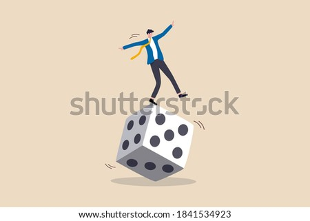 Investment risk, stock trader, gambling, uncertainty, possibility of losing money or make a profit from investment concept, greedy investor man dare trying to balance himself on spinning unstable dice ストックフォト ©