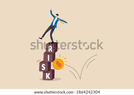 Investment risk, volatility and fluctuation in stock market that price will drop, stability and uncertainty concept, businessman investor falling from stack block with word RISK impact by money coin.