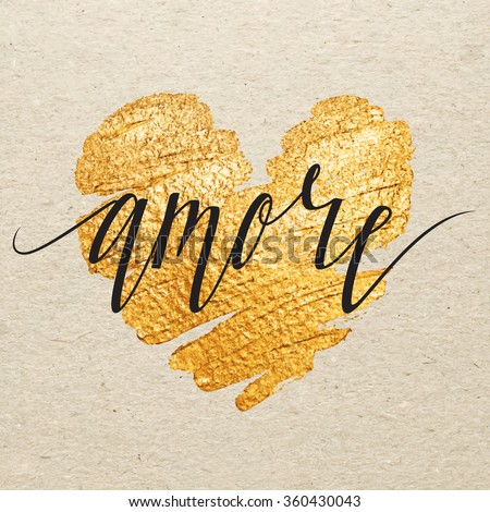 Shutterstock Italian Valentines day card. Amore calligraphy lettering with gold paint heart on craft background. Hand drawn letters.