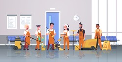 janitors team cleaning service concept.  Male and female cleaners in uniform working together with professional equipment. Modern corridor interior,  flat full length horizontal.