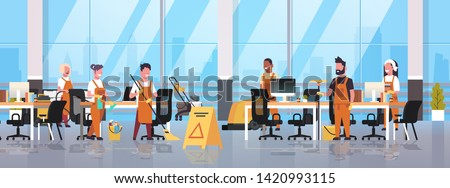 janitors team cleaning service concept male female cleaners in uniform working together with professional equipment modern co-working center office interior flat full length horizontal Photo stock ©
