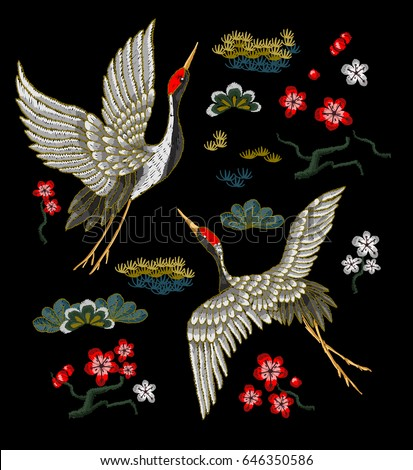 japanese white cranes with red