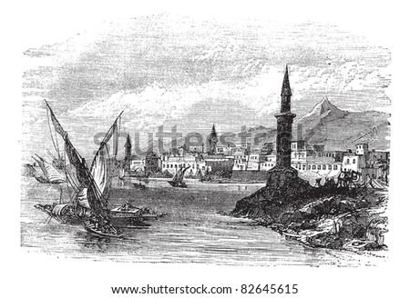Jeddah or Jiddah or Jidda or Jedda in Saudi Arabia, during the 1890s, vintage engraving. Old engraved illustration of Jeddah with moving boats in front.  Trousset encyclopedia (1886 - 1891).