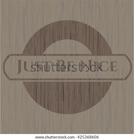 Just Be Nice badge with wood background