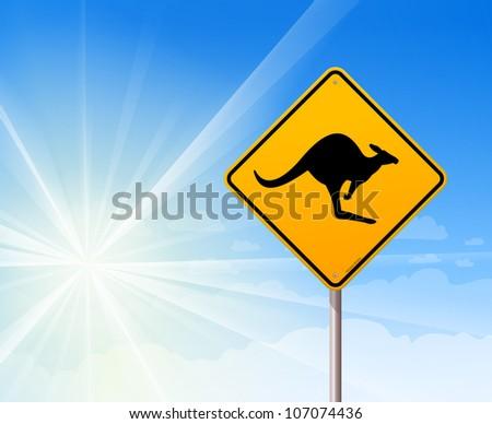 Kangaroo sign on blue sky - Iconic roadsign with black kangaroo animal silhouette