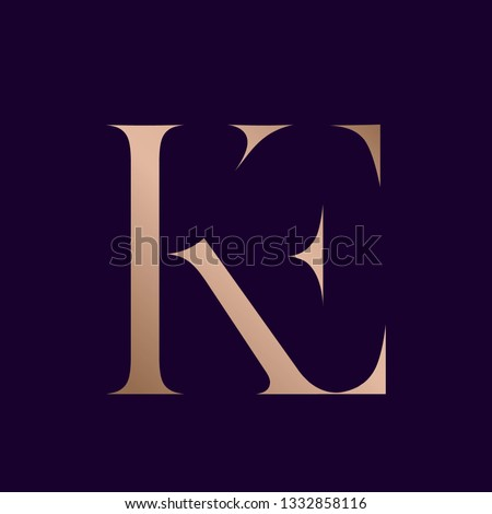 KE monogram.Typographic logo with uppercase letter k and letter e.Serif lettering icon in rose gold metallic color isolated on dark background.Modern, elegant wedding, beauty and style sign. Stok fotoğraf ©