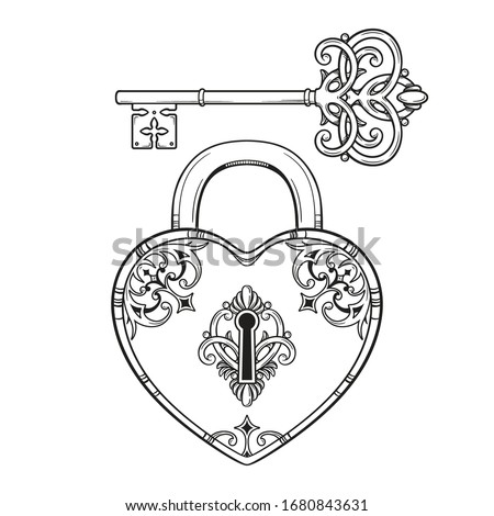 key and heart shaped padlock in