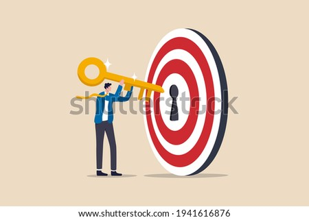 Key to success and achieve business target, KPI, career achievement or secret for success in work concept, businessman putting golden key into bullseye target key hold to unlock business success.