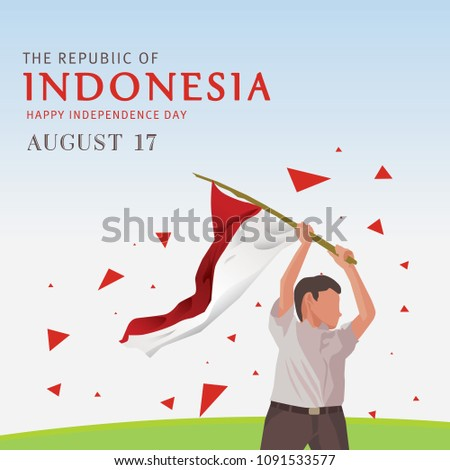 kid holding indonesian flag