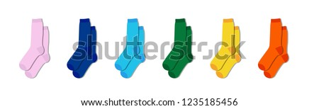 Kids colorful rainbow socks. Children footwear collection. Variety of knitted knee high socks and tights. Child clothing and apparel. Kid fashion.