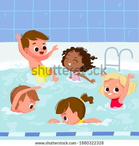 Kids learn how to swim on swimming lesson in pool. Children in aqua park swimming pool having fun.