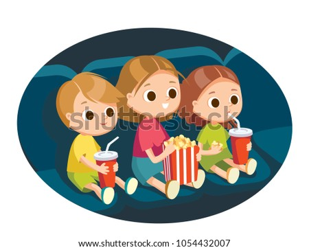 Kids with popcorn in cinema