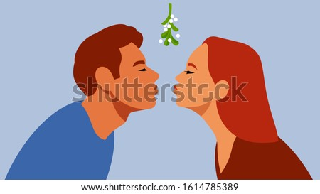 Kiss under the mistletoe branch. The guy and the girl are kissing. A gentle first kiss. Relations, love, date, love, affection, teens.