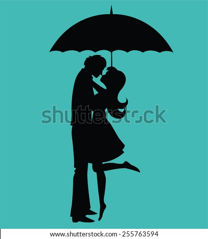 kissing couple under umbrella