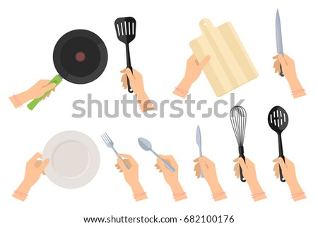 Kitchen steel utensils and kitchenware set. Female hands holding frying pan and plastic slotted spatula, ceramic dish, stainless fork, spoon and table-knife, wooden cutting board and knife.